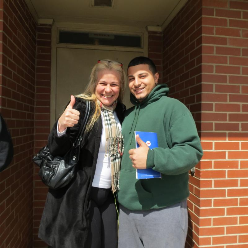 Nineteen-year-old Pedro Caram, who has deferred status, gives the license a thumbs-up with his mother Anna Caram. He was born in Brazil and came to the U.S. when he was five.