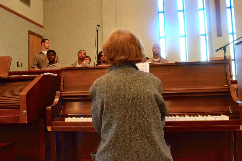 Millicent Gordon directs members of Western Youth Instutition's Choir. The 84 year-old music teacher has been instructing youth offenders for thirty years.