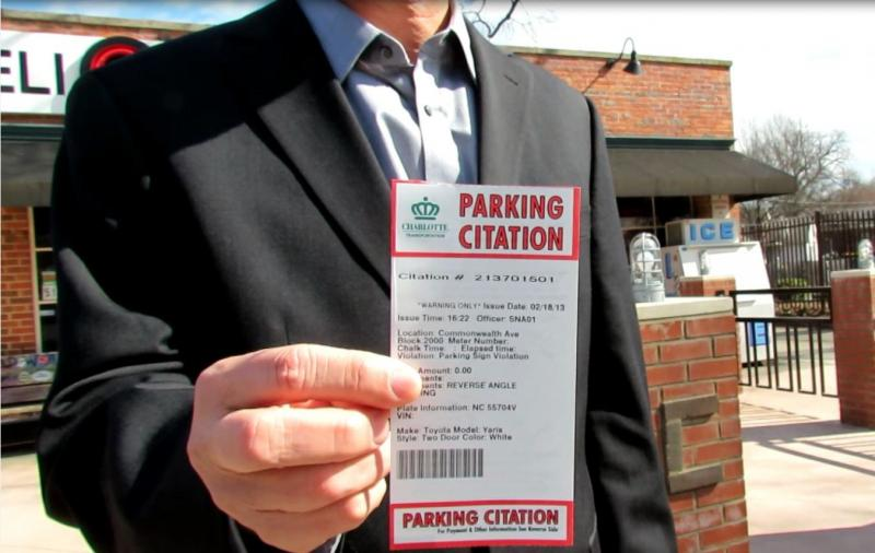 Jim Keenan, an engineer with the city of Charlotte, shows off the parking ticket people will receive starting April 1, 2013 if they don't park correctly.