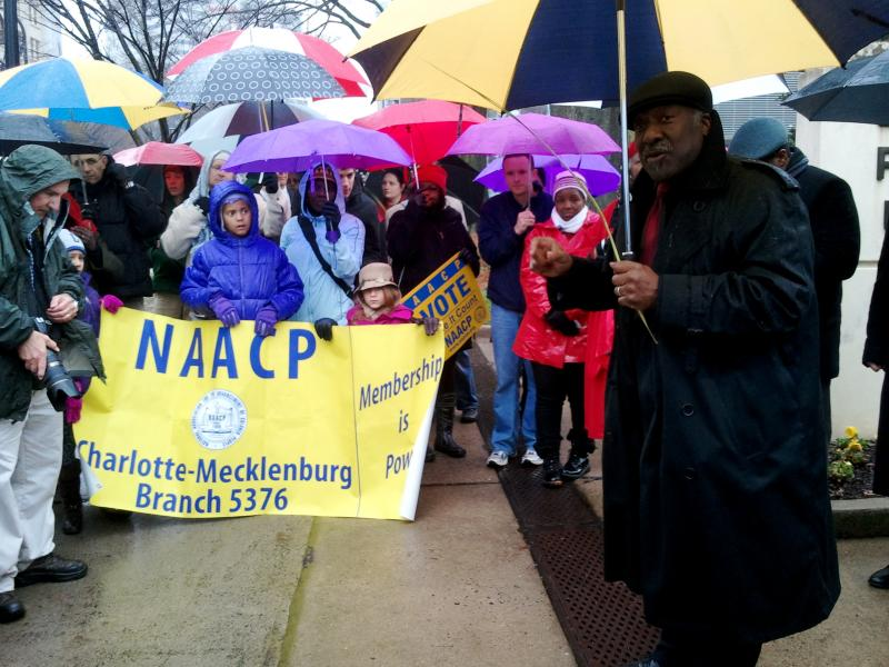 Charlotte NAACP President Kojo Nantambu speaks to marchers in front of the federal courthouse.