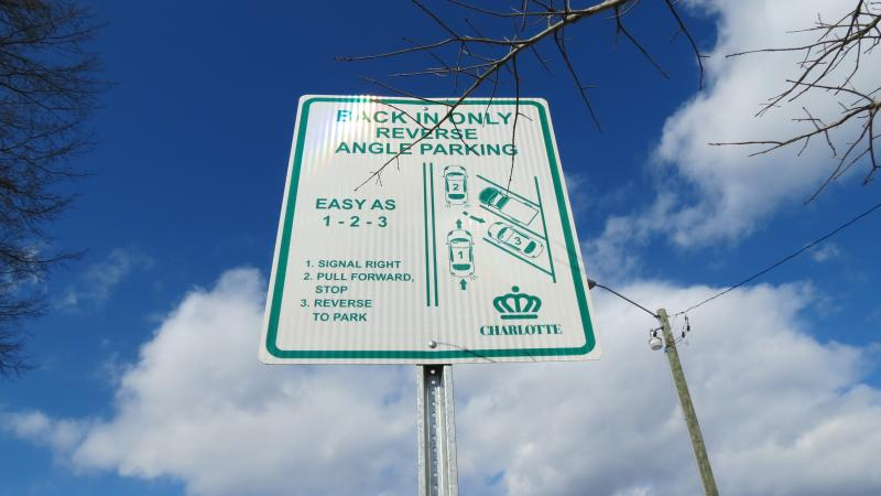Reverse Angle Parking signs line Commonwealth Avenue in Plaza Midwood.