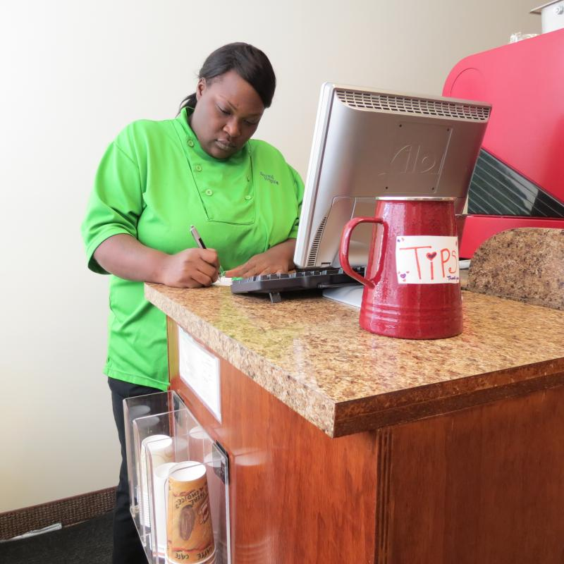 Candice Ikard works at the Second Helping coffee and food cart