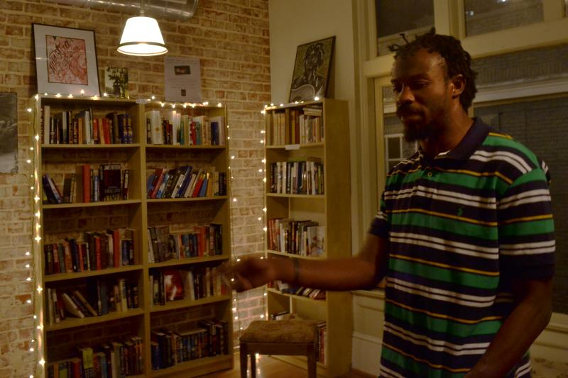 Williams recites a poem at an open mic night at Poor Richards Bookshop. He has self-published 5 books of poetry and says he has written over 1,300 poems.