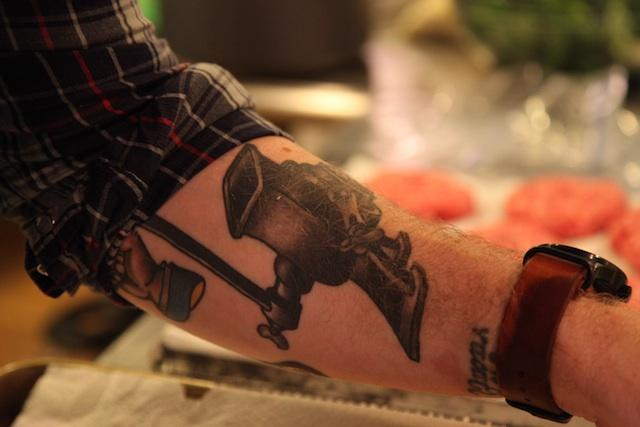 Wil's tattoo of a meat mincer pays homage to his grandfather who handmade sausage on his farm in Waynesboro, GA.