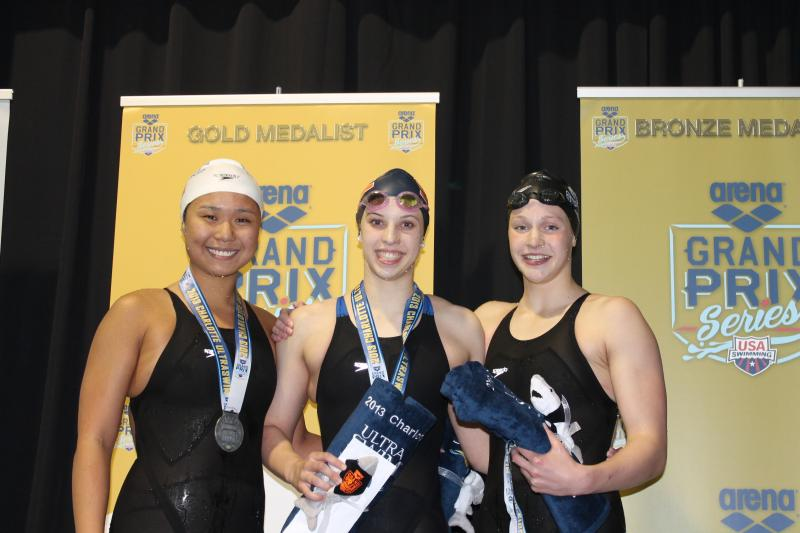 Kathleen Baker of the SwimMAC team takes first place on the podium after winning the 200 IM.
