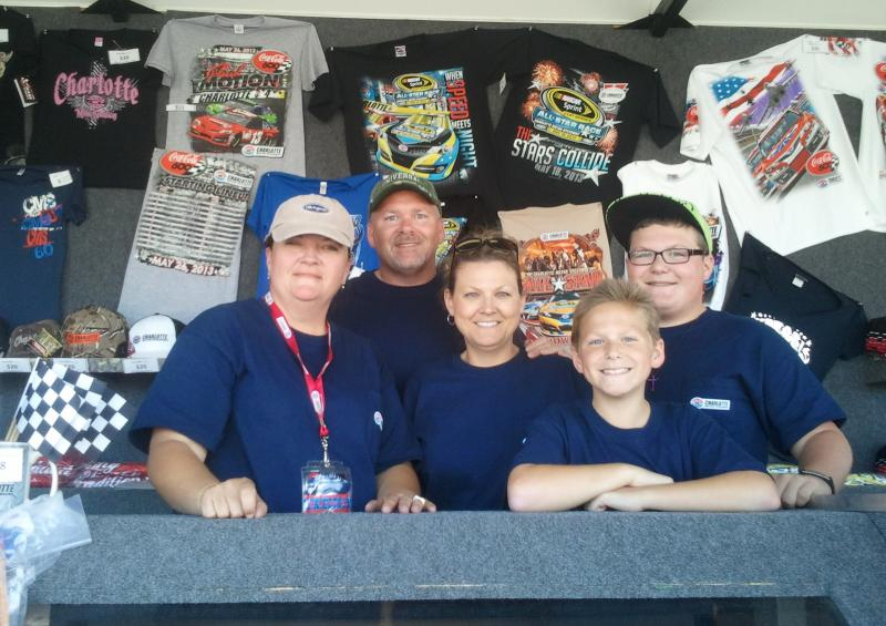 Tina Conder and a family from the Mount Pleasant Swim Club sell NASCAR merchandise at the speedway.