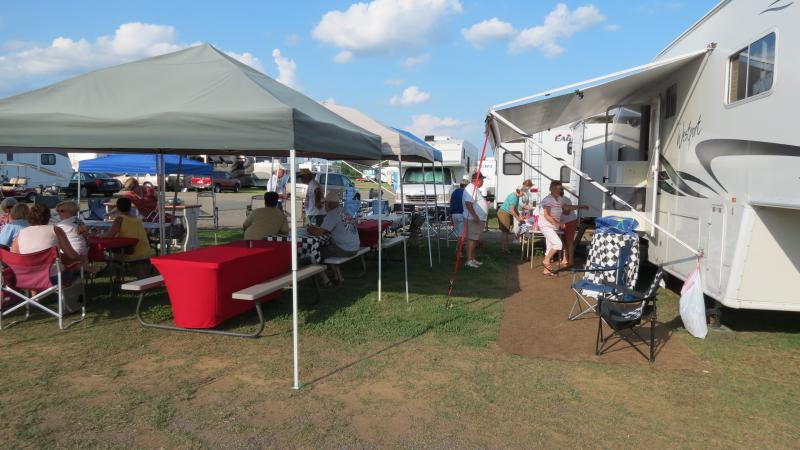 Harry Wiley and his friends get ready for a potluck dinner at the family campground at the Charlotte Motor Speedway.