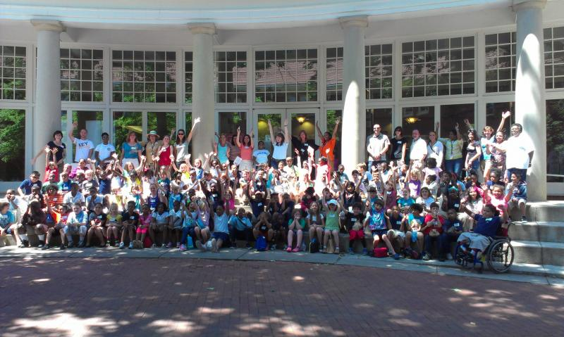 All of the participating pen pals, teachers and volunteers take a group shot at Queens University.