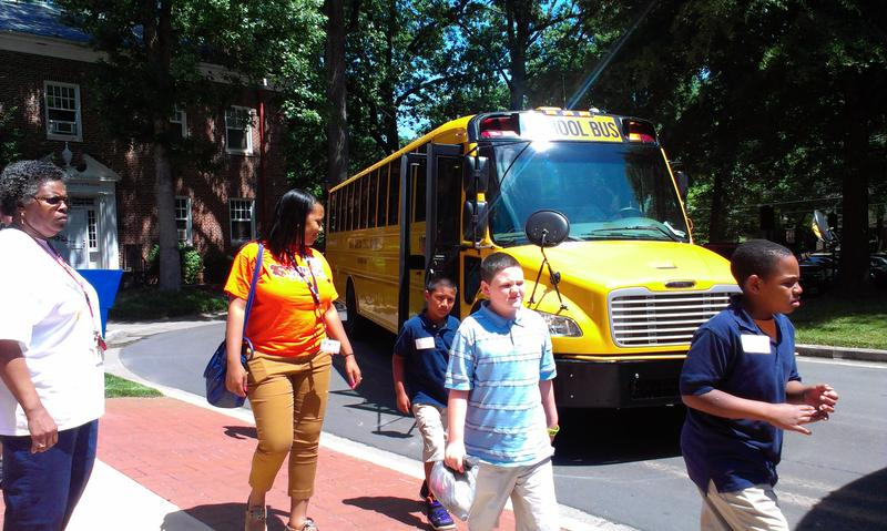 Sedgefield Elementary school students get off the bus to meet their pen pals.