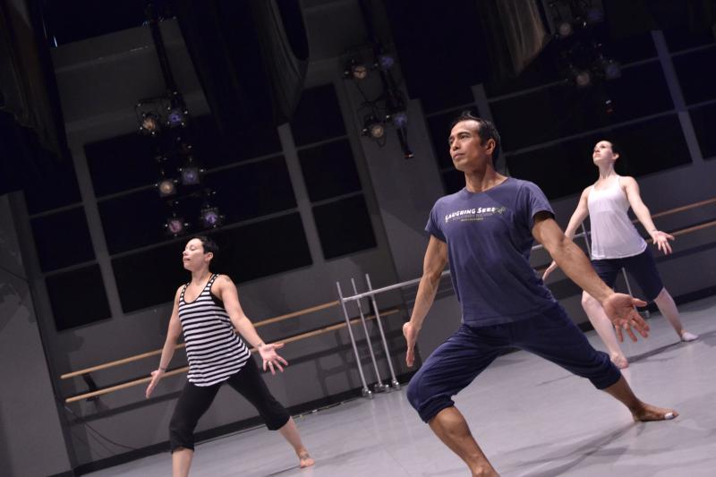 UNCC professor E.E. Balcos, at center, practices with several local dancers for Friday's performance of Deep Water: The Murder Ballads. Balcos and composer John Allemeier have been working together on Deep Water for about two years.