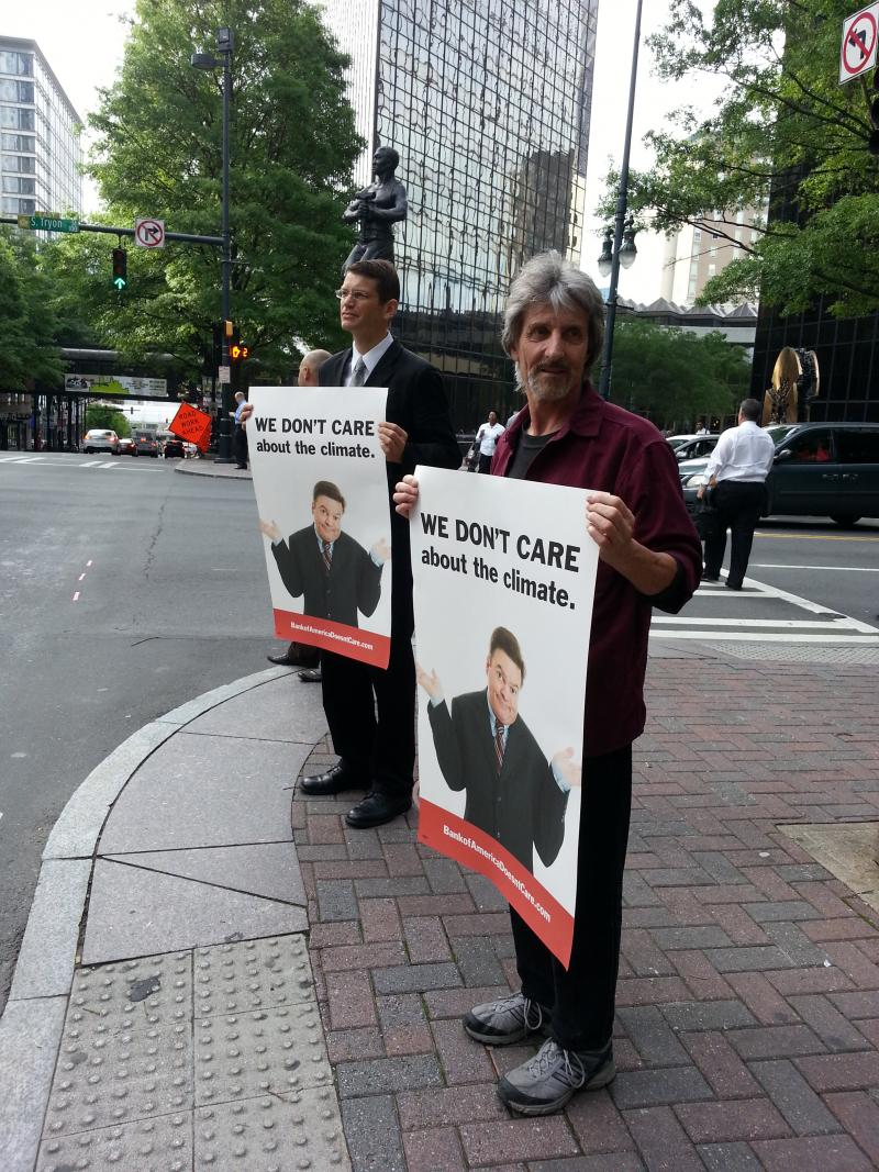 About two dozen protesters with the Rainforest Action Network stood outside the Bank of America Annual Shareholders meeting in Charlotte on Wednesday.