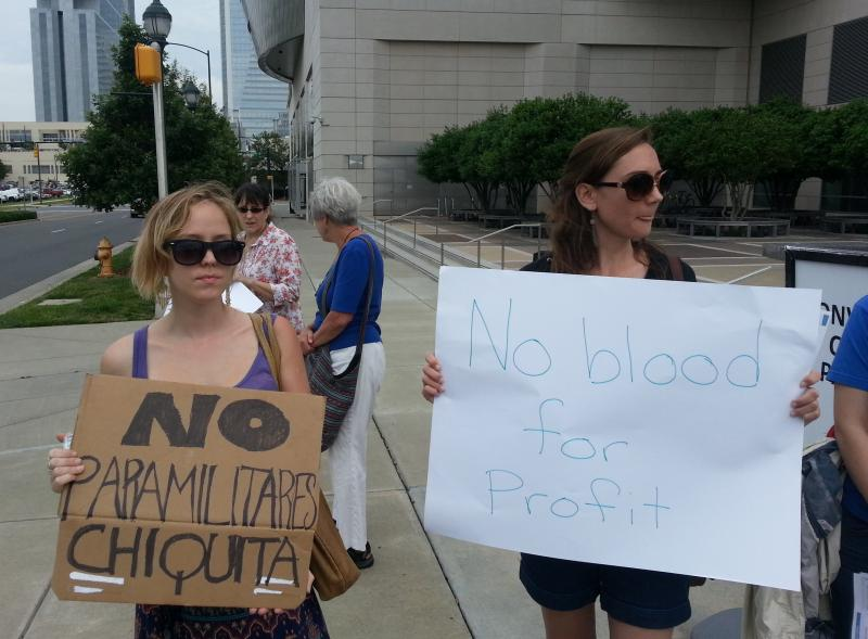 Durham residents Laura Eshelman and Emily Zucchino protest outside Chiquita's 2013 annual shareholdes meeting in Charlotte.