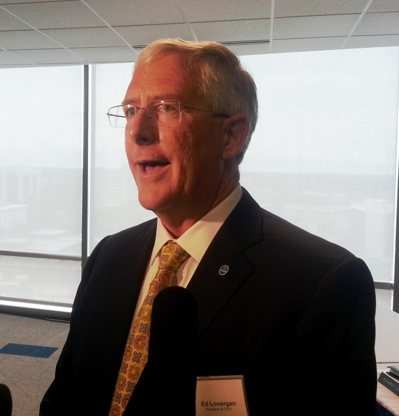 Chiquita CEO Ed Lonergan speaks with reporters after the 2013 annual shareholders meeting in Charlotte.