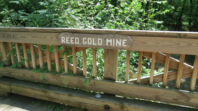 A sign right above Little Meadow Creek where the first discovery of gold was made in 1799.