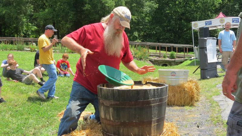 A Pan-O-lympics participant at The Reed Gold Mine finishes the speed panning event in style.