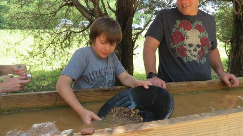 Mikey Marimpietri, 11, found a flake of gold during his visit to the Reed Gold Mine. Visitors are allowed to keep the gold they find at the panning station.