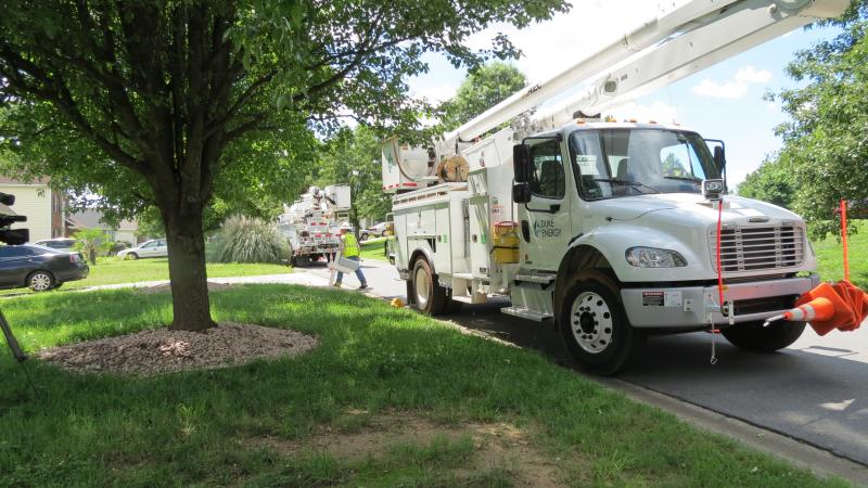 Duke Energy power crews outside a home in North Charlotte