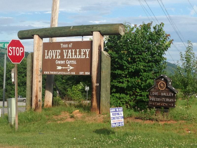 Signs mark the way from I-40 to Love Valley