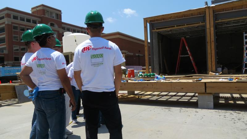 Ingersoll Rand employee, Mahfuz Imam, second from right, talks with students about the structure of the building.