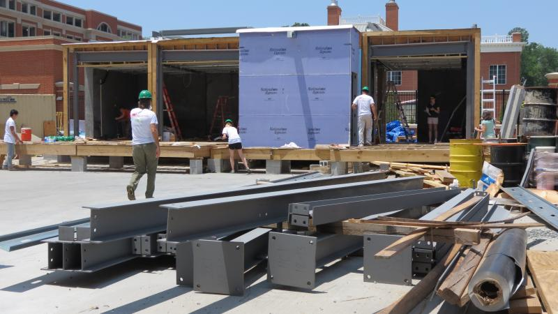 UNC Charlotte's Solar Decatholon team says it's halfway done building its solar-powered house for the competition this fall.