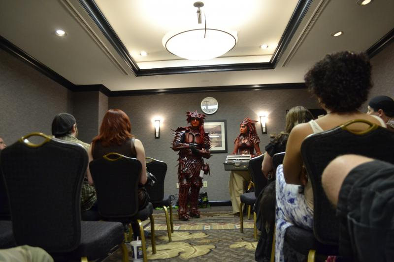 A couple dressed in leather devils outfits explains how they made the outfits. The convention hosted three days of panels, which covered a range of sci-fi and paranormal topics.
