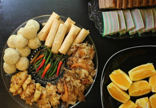 An assortment of Indonesian appetizers including onde-onde, lumpia and shrimp/cabbage fritters