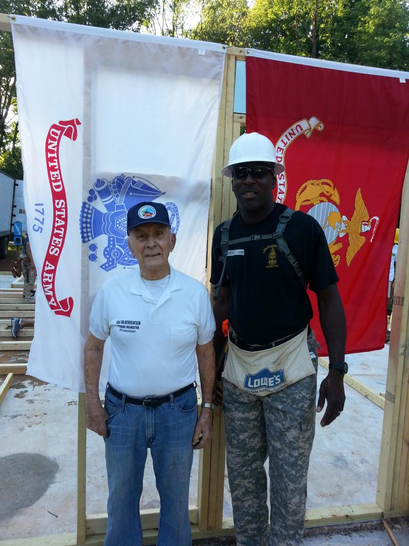 97-year old Jean Varda is a WWII veteran offering 'moral support' to Darryl White and other veterans working on a Habitat Charlotte home build.