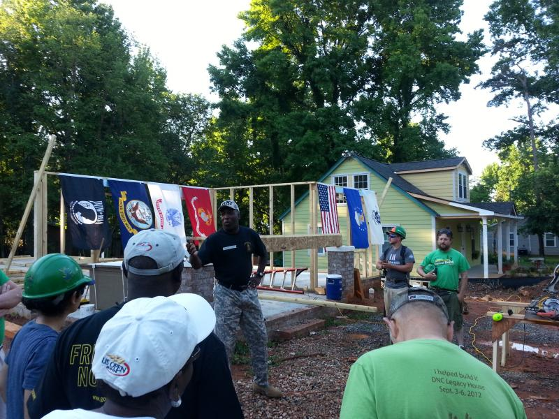 Habitat employee and army veteran Darryl White kicks-off construction on a home that will be dedicated July 3.