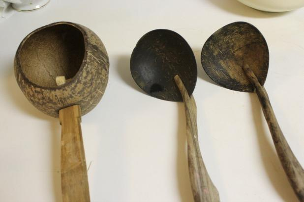 Traditional Indonesian cooking tools made from coconuts and wood.