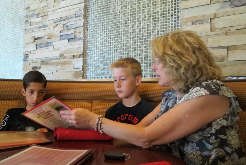 Cindy Gunter takes her family to the Fusion Bowl restaurant in Lake Norman after Menhaj's appointment.