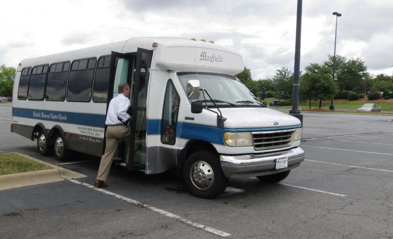 Henry Trexler boards Mayfield Memorial Baptist Church's bus from Charlotte to Raleigh for the protests.