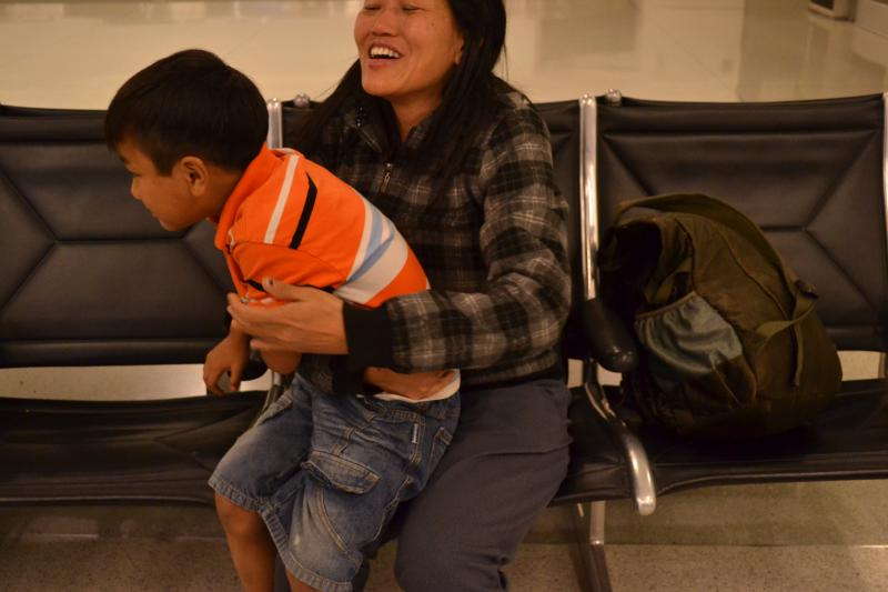 Moments after arriving to the Charlotte airport as refugee, Khup Than Lun embraces her great-nephew. The two haven't seen eachother in two years, since they were both living in Malaysia after fleeing Burma.
