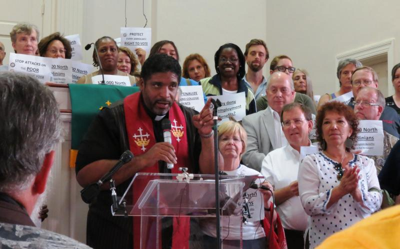 Volunteers for arrest stood behind Rev. William Barber, president of North Carolina NAACP, at a rally at Christian Faith Baptist Church in Raleigh..