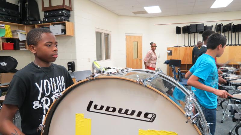 Damontre Harris plays bass drum in Ashley Park's drum line