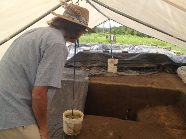 Archeologist David Moore looks at the remains of the Fort San Juan moat.