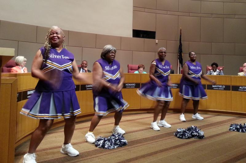 The Silver Foxes perform a cheer in honor of Charlotte Mayor Anthony Foxx, who stepped down Monday to become U.S. Secretary of Transportation.