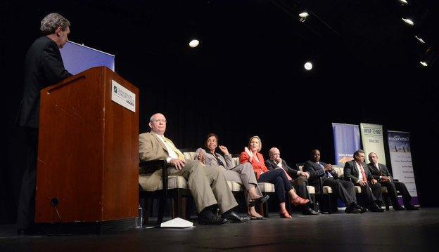 "Moderator Mike Collins, WFAE ""Charlotte Talks"" host, (left),   panelists (from left), Rep. Bill Brawley, Rep. Beverly Earle, Rep.   Ruth Samuelson, Sen. Dan Clodfelter, Sen. Malcolm Graham, Sen. Bob   Rucho, Sen. Jeff Tarte."