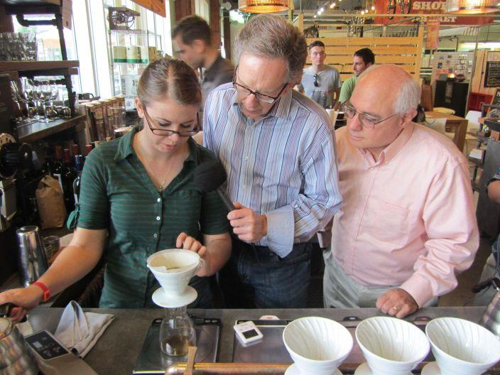 "Kelsey Viscount demonstrates the ""pour over"" method at Not Just Coffee with Mike Collins and Peter Reinhart"