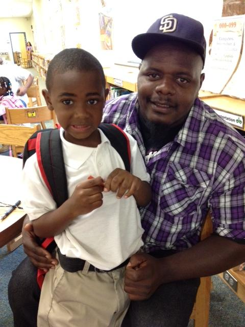 Dontay Kilgo brings his son to school