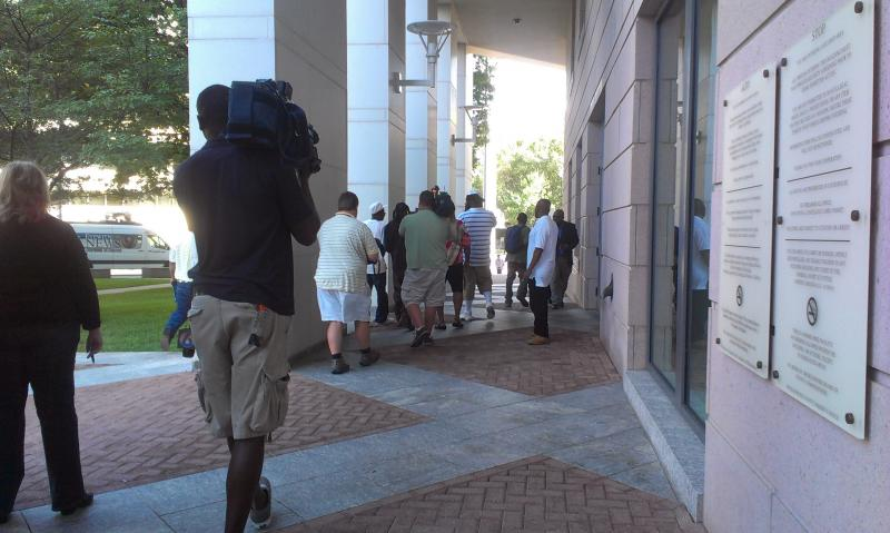 Members of the media follow alleged members of the Hidden Valley Kings and their family members as they leave the courthouse after the injunction.