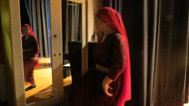 Lina Baddar, 23, from Jordan, practices the dabke steps backstage, before the performance.