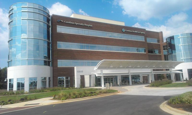 Carolinas Specialty Hospital opened its doors to patients for the first time Wednesday.