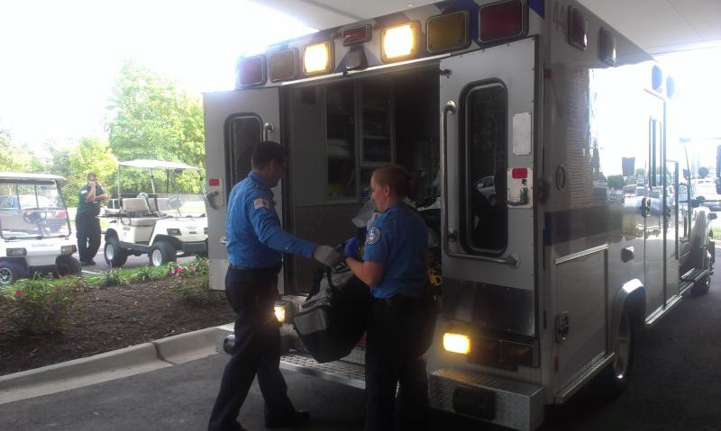 Medics move a patient inside the hospital from the ambulance.