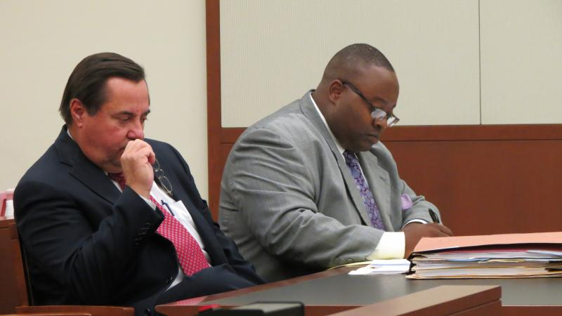 Attornies for CMPD officer Randall Kerrick, George Laughrun and Michael Greene, listen to Senior Deputy Attorney General James Coman ask the judge to block the release of the dash-cam video.