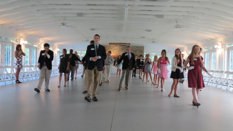 "Students practice the grapevine steps to Darius Rucker's song ""Wagon Wheel"" at the Birkdale Golf Club Pavilion."