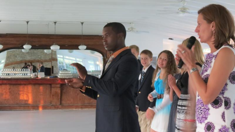 Michael Dorsainvil, a senior at Lake Norman Charter High School, demonstrates how ladies should clap their hands: slightly cupped, with the left hand clapping the right.
