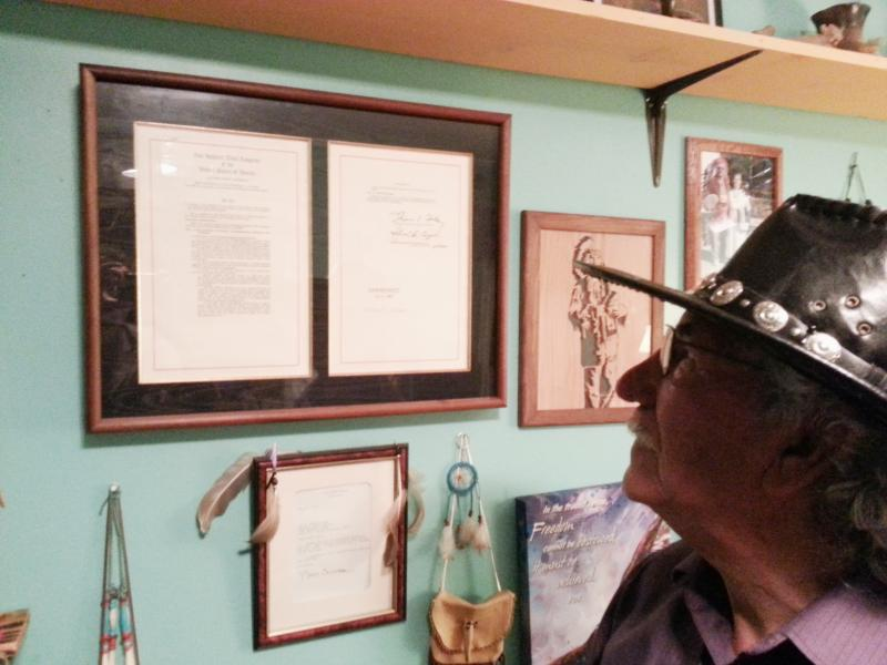 "A framed copy of the ""Catawba Indian Land Claims Settlement Act of 1993"" hangs on the wall in Gilbert Blue's home."
