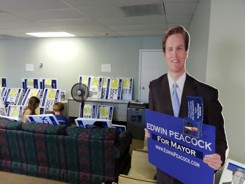 """For Mayor"" replaces the words ""For Congress"" on Peacock's campaign signs and life-sized cutout. This is Peacock's third race in as many years."
