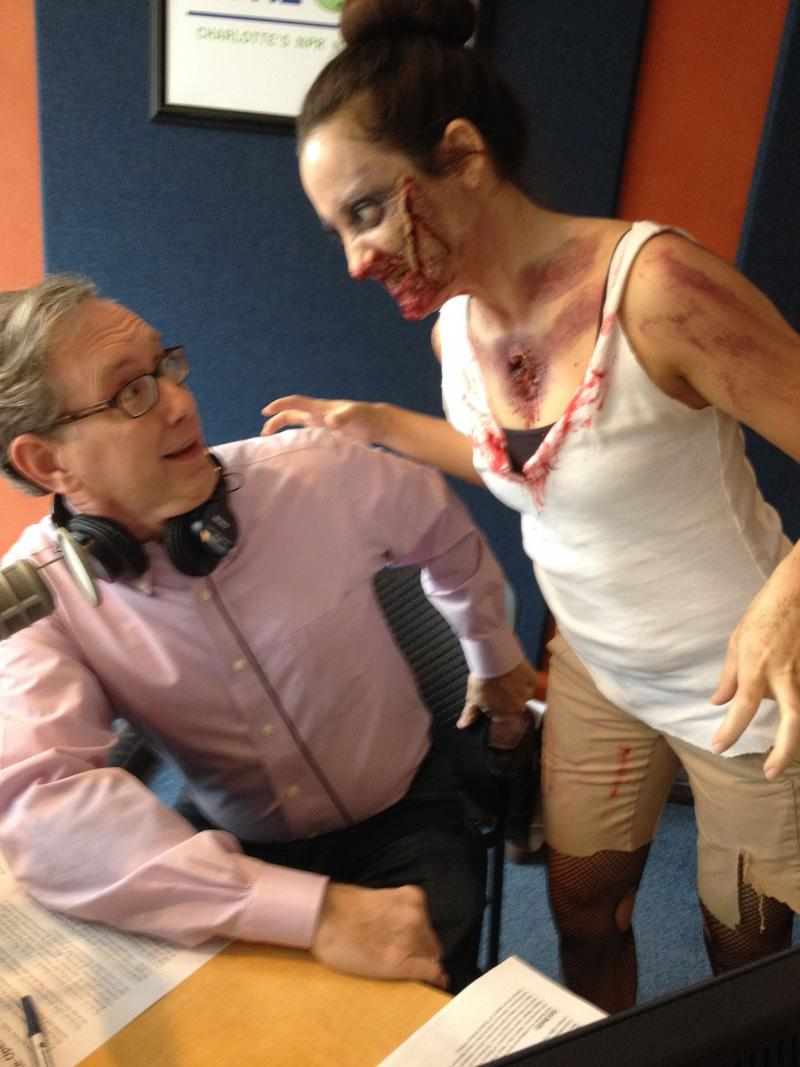 Zombie talk show producer Alexia preys on Mike Collins. We're talking ZOMBIES this morning! Makeup artist Katie Bearden made over Alexia this morning into the undead.