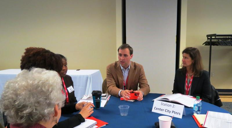 Tobe Holmes of Center City Partners talks with AARP members and summit participants.